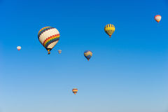 Hot air balloon flying over Cappadocia Royalty Free Stock Image