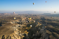 Hot air balloon flying over Cappadocia Stock Photos