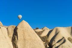 Hot air balloon flying over Cappadocia Stock Photo
