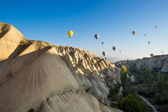 Hot air balloon flying over Cappadocia Royalty Free Stock Images