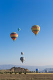Hot air balloon flying over Cappadocia Royalty Free Stock Photo