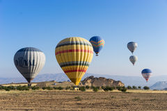 Hot air balloon flying over Cappadocia Royalty Free Stock Image