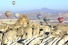 Hot air balloon flying over Cappadocia. Royalty Free Stock Images