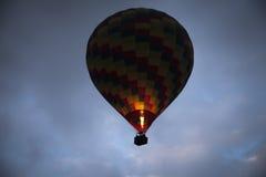 Hot air balloon flying over Cappadocia Turkey Royalty Free Stock Photography
