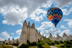 Hot air balloon flying over Cappadocia, Turkey stock photos