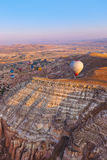 Hot air balloon flying over Cappadocia Turkey Stock Photo