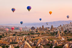 Hot air balloon flying over Cappadocia Turkey Royalty Free Stock Photography