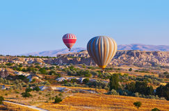 Hot air balloon flying over Cappadocia Turkey Royalty Free Stock Images