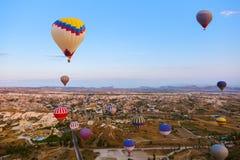 Hot air balloon flying over Cappadocia Turkey Royalty Free Stock Photos