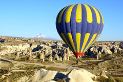 Hot air balloon flying over with Erciyes volcano. Stock Images