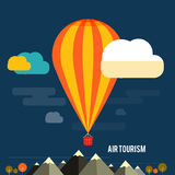 Hot air balloon flying over the mountain Royalty Free Stock Images