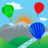 Hot air balloon flying over mountain landscape Royalty Free Stock Image