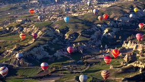 Hot air balloon flying over rock landscape at Cappadocia Turkey stock photos