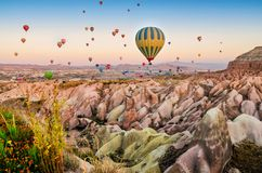 Hot air balloon flying over rock landscape at Cappadocia Turkey. In September Royalty Free Stock Images