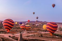 Hot air balloon flying over spectacular Cappadocia, Tourists enjoy the overwhelming views over Cappadocia, Turkey stock images