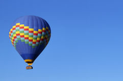 Hot Air Balloon Flying. A photo of a hot air balloon in flight Stock Images