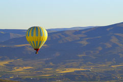 Hot Air Balloon Flying. A photo of a hot air balloon in flight Royalty Free Stock Photo