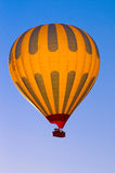 Hot Air Balloon Flying. A photo of a hot air balloon in flight Stock Photography