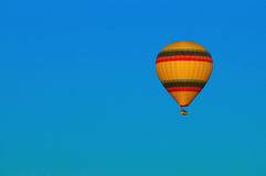 Hot Air Balloon Flying. A photo of a hot air balloon in flight Royalty Free Stock Image
