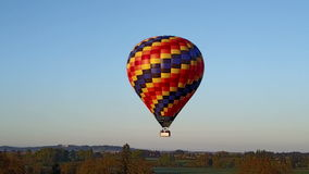 Hot air balloon flying in the rural area. This is an aerial video of a hot air balloon flying in the rural area of Oregon state stock video footage