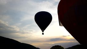 Hot air balloon flying in the sky. Hot air balloon flying in the cloudy sky stock video