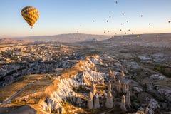 Hot air balloon flying at sunrise Royalty Free Stock Photos