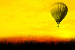 Hot air balloon flying at sunset Stock Images