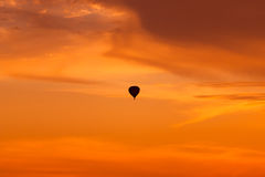 Hot air balloon flying at sunset sky Stock Photography
