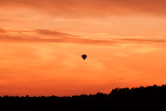 Hot air balloon flying at sunset sky Royalty Free Stock Photo