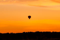Hot air balloon flying at sunset sky Stock Photos