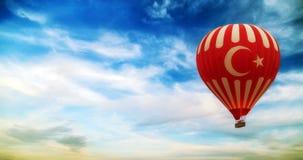 Hot air balloon flying turkey flag. Turkey flag hot air balloon flying blue sky with clouds stock photos