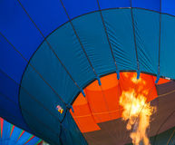 Hot Air Balloon getting fired up to inflate Stock Photography