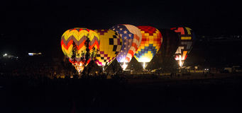 Hot-Air Balloon Glow. Hot-air balloons light up and glow in the dark night Royalty Free Stock Photos