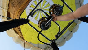 Hot air balloon going up. Short bursts of hot air balloon burner to keep going up stock video