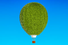 Hot air balloon from green grass, 3D. Rendering Royalty Free Stock Photo