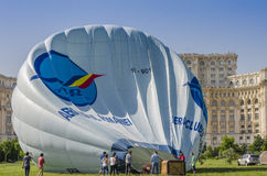 Hot air balloon on the ground. Hot air balloon being inflated at the Red Bull Ordinul Smaranda competition on June 7, 2014 in Bucharest, Romania Stock Photo