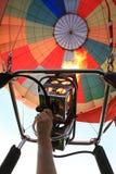 Hot air balloon. Hand controls the burner of the air balloon Stock Photos