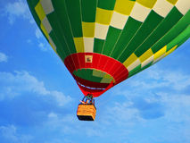 Hot air balloon high in the sky Royalty Free Stock Image