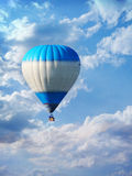 Hot air balloon high in the sky Royalty Free Stock Photography