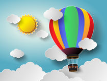 Hot air balloon high in the sky with sunlight.Vector illustration. Paper cut style vector illustration