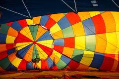 Hot air balloon. Colorful aerostat inflating, blue sky royalty free stock photo