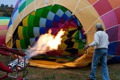 Hot air balloon inflating. ROCAMADOUR, FRANCE- SEPTEMBER 24: Hot air balloon inflating at dawn for the 26ème Montgolfiades de Rocamadour, on September 24, 2011 Stock Photo