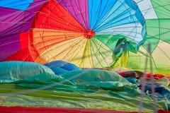 Hot air balloon inflating inside view, man shadow Stock Image