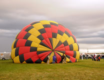 Hot air balloon inflating in the morning Royalty Free Stock Photography