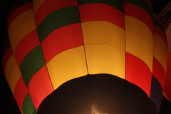 Hot Air Balloon inflating at Night Stock Image