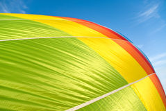 Hot air balloon inflation. Close up of a colourful hot air balloon during inflation in a serene day royalty free stock image