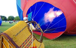 Hot Air Balloon Inflation. Pilot Mike Scott hot inflating his balloon at the Pennington Balloon Championship in Baton Rouge, Louisiana on August 8, 2008.  Mr Stock Photos
