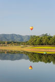Hot air balloon isolated on sky Stock Images