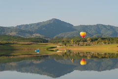 Hot air balloon isolated on sky. Colorful hot-air balloons flying over the mountain Royalty Free Stock Photos
