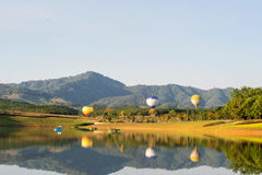 Hot air balloon isolated on sky. Colorful hot-air balloons flying over the mountain Stock Images